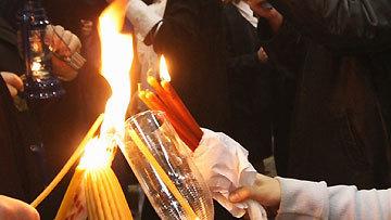 Благодатный огонь сошел в храме Гроба Господня в Иерусалиме   © РИА Новости. Михаил Фомичев
